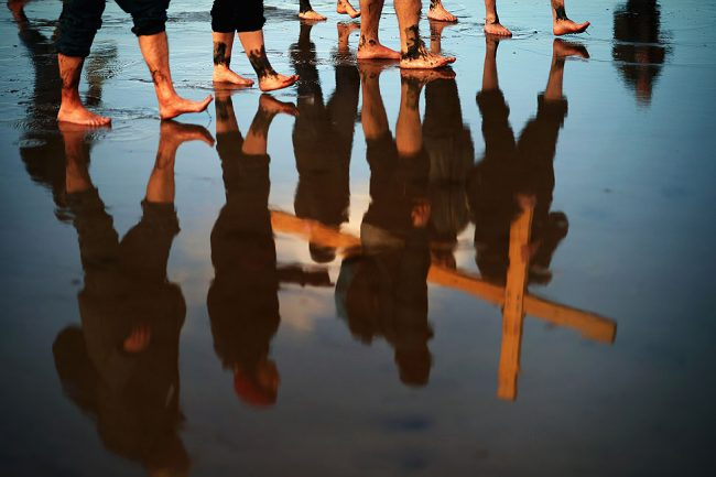 Pilgrims walk with crosses as the Northern Cross pilgrimage makes its final leg of the journey to Holy Island in Berwick-upon-Tweed, England. More than 50 people, young and old, celebrated Easter by crossing the tidal causeway during the annual Christian pilgrimage.